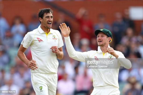 Cameron Bancroft of Australia congratulates team mate Mitchell Starc of Australia after dismissing Mark Stoneman of England during day four of the...