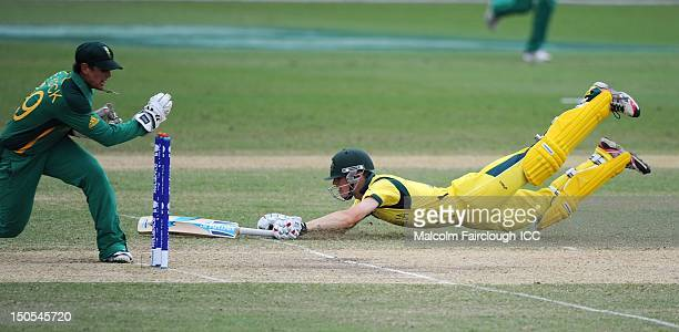 Cameron Bancroft of Australia dives to make his ground as Quinton De Kock of South Africa attempts to run him out during the ICC U19 Cricket World...