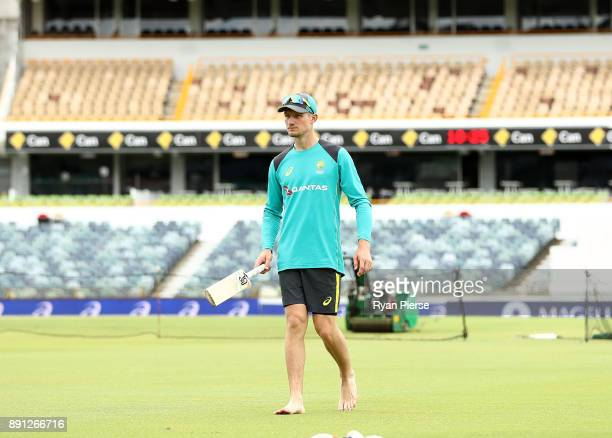 Cameron Bancroft of Australia inpects the pitch during an Australian nets session ahead of the Third Test of the 2017/18 Ashes Series at the WACA on...