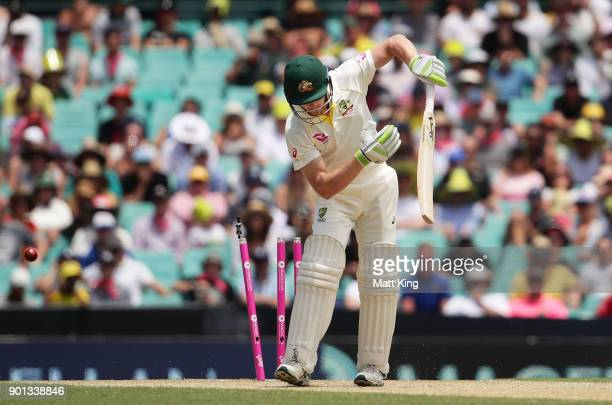 Cameron Bancroft of Australia is bowled by Stuart Broad of England during day two of the Fifth Test match in the 2017/18 Ashes Series between...