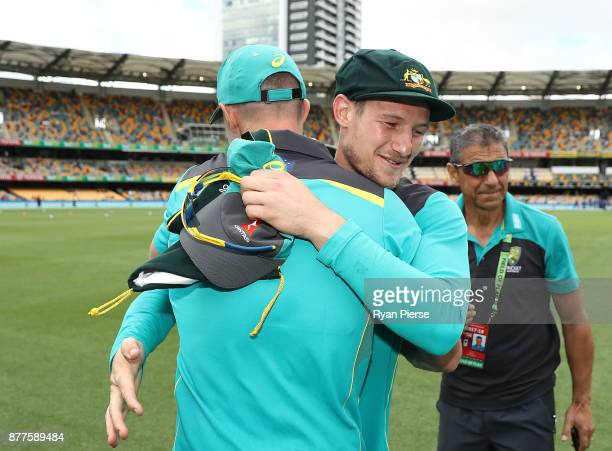 Cameron Bancroft of Australia is congratulated after he was presented with his Baggy Green Cap during day one of the First Test Match of the 2017/18...