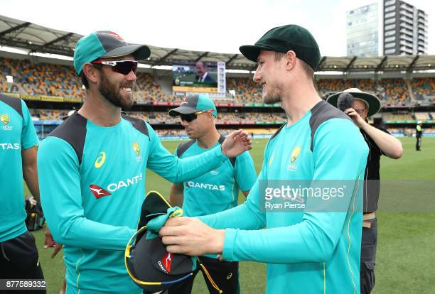 Cameron Bancroft of Australia is congratulated by Glenn Maxwell of Australia after he was presented with his Baggy Green Cap during day one of the...