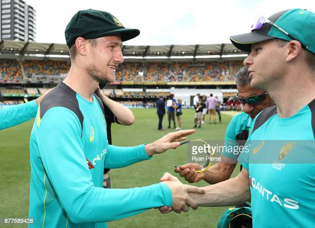 Cameron Bancroft of Australia is congratulated by Steve Smith of Australia after he was presented with his Baggy Green Cap during day one of the...