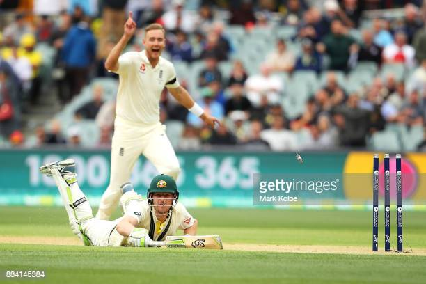 Cameron Bancroft of Australia looks dives for the crease as he is run out by Chris Woakes of England during day one of the Second Test match during...