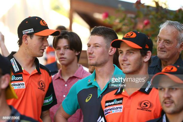 Cameron Bancroft of Australia looks on with team mates and family before addressing the media after being added into the WACA ground's Test Player...