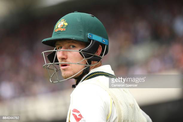 Cameron Bancroft of Australia looks onto the field as he heads out to bat during day one of the Second Test match during the 2017/18 Ashes Series...