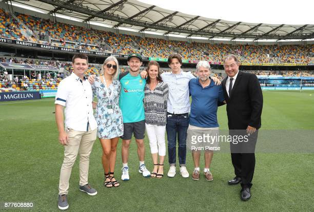 Cameron Bancroft of Australia poses wit his family after he was presented with his Baggy Green Cap during day one of the First Test Match of the...