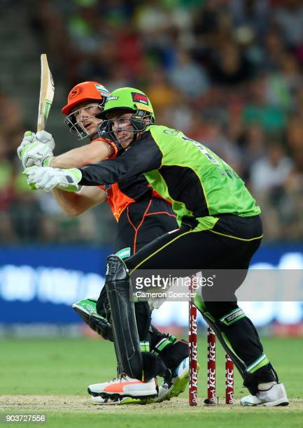 Cameron Bancroft of the Scorchers bats in front of Jay Lenton of the Thunder during the Big Bash League match between the Sydney Thunder and the...