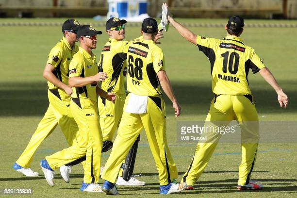 Cameron Bancroft of the Warriors celebrates after taking a catch to dismiss Dan Christian of the Bushrangers during the JLT One Day Cup match between...