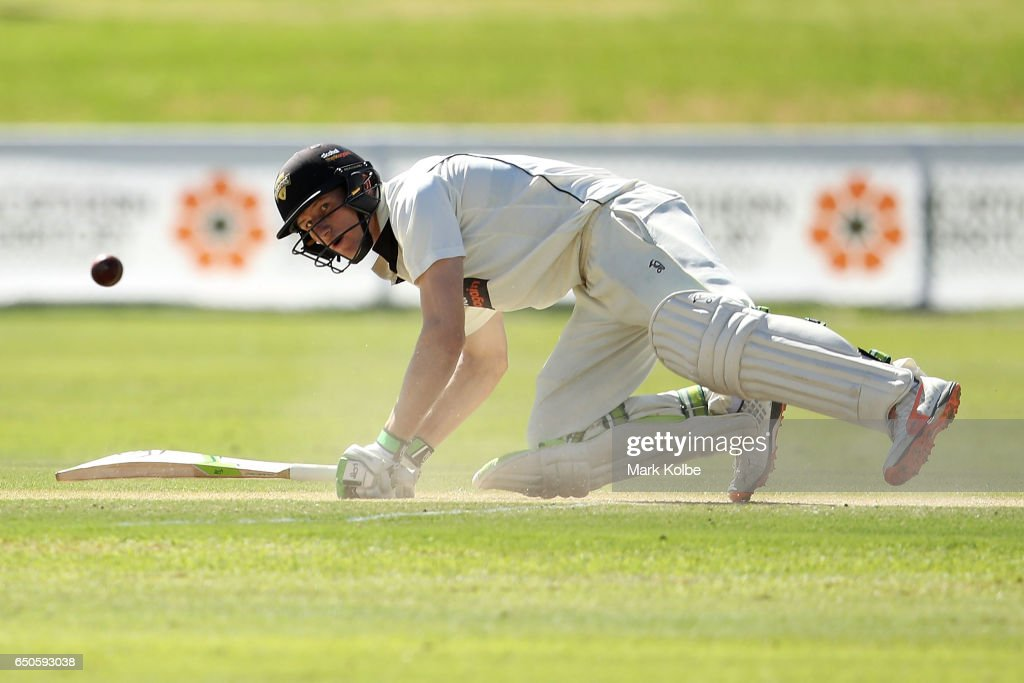 Cameron Bancroft of the Warriors looks up after falling as he was trapped LBW by James Pattinson of the Bushrangers during the Sheffield Shield match between Victoria and Western Australia at Traeger Park on March 10, 2017 in Alice Springs, Australia.