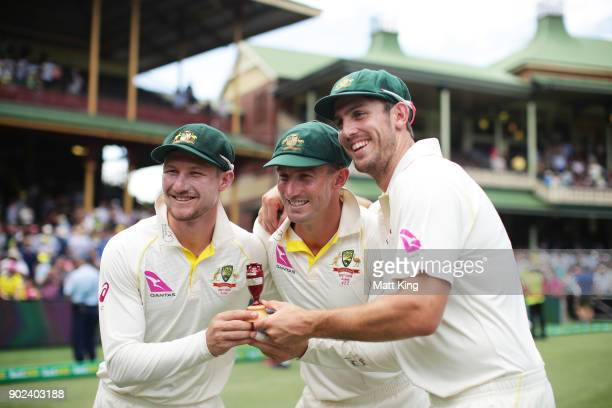 Cameron Bancroft Shaun Marsh and Mitchell Marsh of Australia celebrate winning the Ashes during day five of the Fifth Test match in the 2017/18 Ashes...