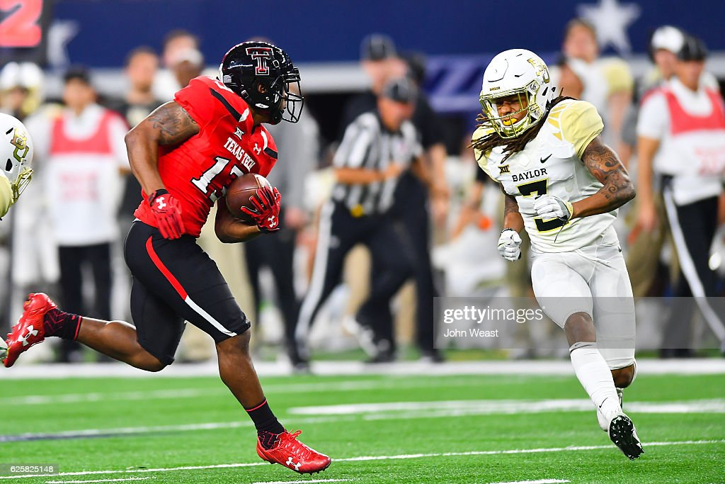 Cameron Batson #13 of the Texas Tech Red Raiders looks to get around Tion Wright #3 of the Baylor Bears during the game on November 25, 2016 at AT&T Stadium in Arlington, Texas. Texas Tech defeated Baylor 54-35.