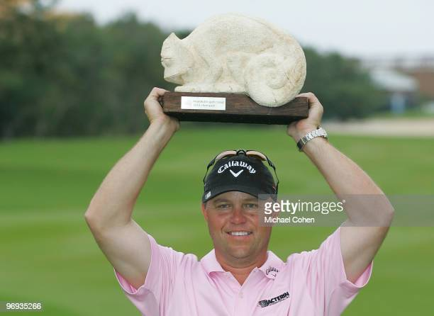 Cameron Beckman holds the trophy after winning the Mayakoba Golf Classic at El Camaleon Golf Club held on February 21, 2010 in Riviera Maya, Mexico.