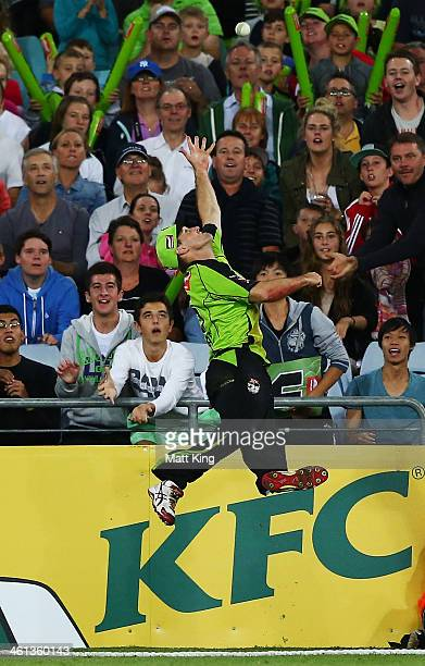 Cameron Borgas of the Thunder attempts a catch over the boundary during the Big Bash League match between Sydney Thunder and Brisbane Heat at ANZ...