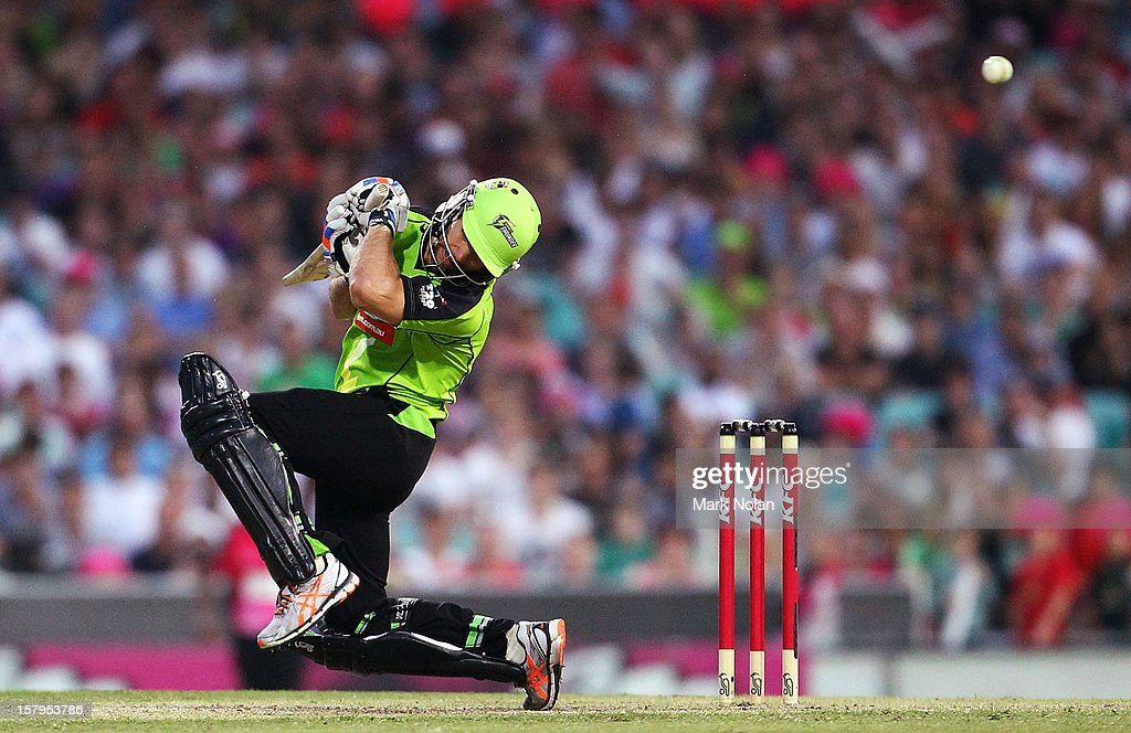 Cameron Borgas of the Thunder ducks a bouncer by Mitchell Starc of the Sixers during the Big Bash League match between the Sydney Sixers and the Sydney Thunder at Sydney Cricket Ground on December 8, 2012 in Sydney, Australia.