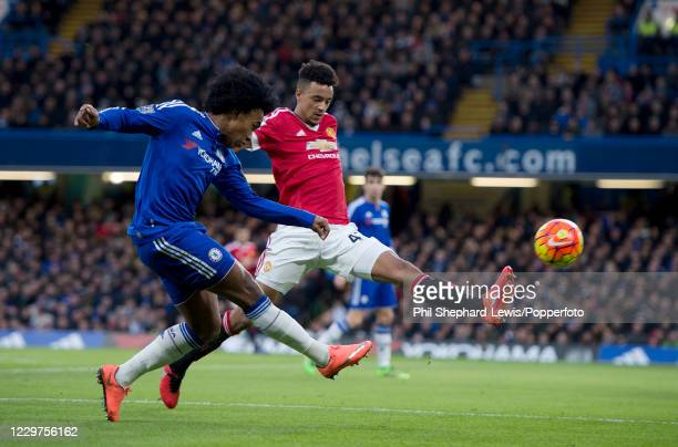 Cameron Borthwick-Jackson of Manchester United attempts to block the cross from Willian of Chelsea during a Barclays Premier League match at Stamford...