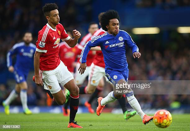 Cameron Borthwick-Jackson of Manchester United closes down Willian of Chelsea during the Barclays Premier League match between Chelsea and Manchester...