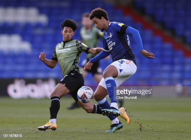 Cameron Borthwick-Jackson of Oldham Athletic and Courtney Senior of Colchester United during the Sky Bet League Two match between Oldham Athletic and...