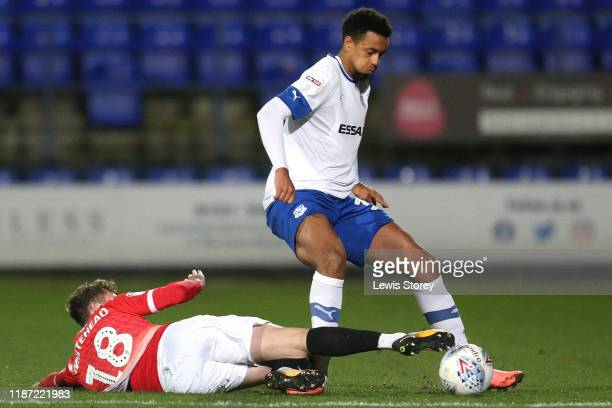 Cameron Borthwick-Jackson of Tranmere Rovers is challenged by Danny Whitehead of Salford City during the Leasing.com Trophy Northern Group C match...