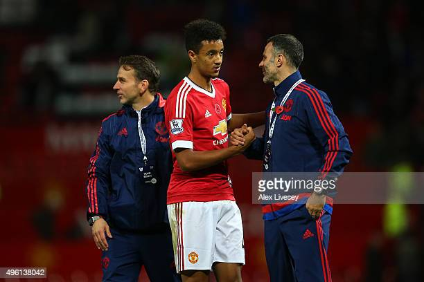 Cameron Borthwick-Jackson shakes hands with assistant manager Ryan Giggs after their team's 2-0 win in the Barclays Premier League match between...
