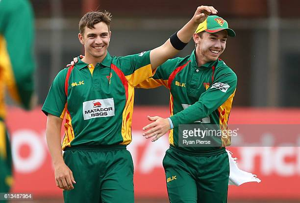 Cameron Boyce and Jake Doran of the Tigers celebrate after Boyce claimed the wicket of Peter Nevill of the Blues during the Matador BBQs One Day Cup...