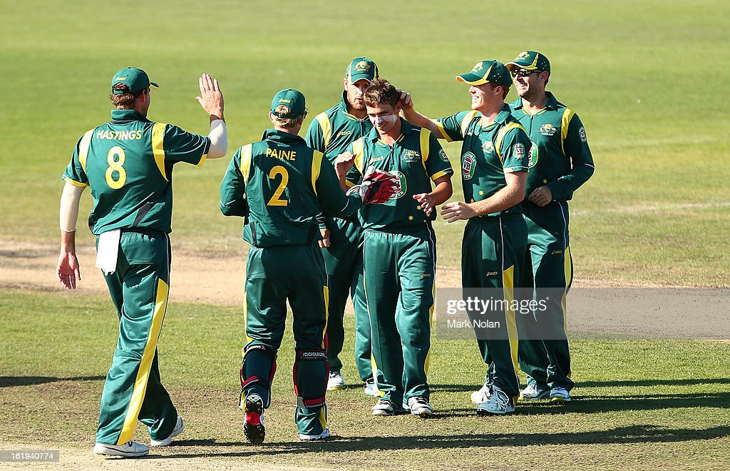 Cameron Boyce of Australia A is congratulated by team mates after getting a wicket during the international tour match between Australia 'A' and England at Blundstone Arena on February 18, 2013 in Hobart, Australia.