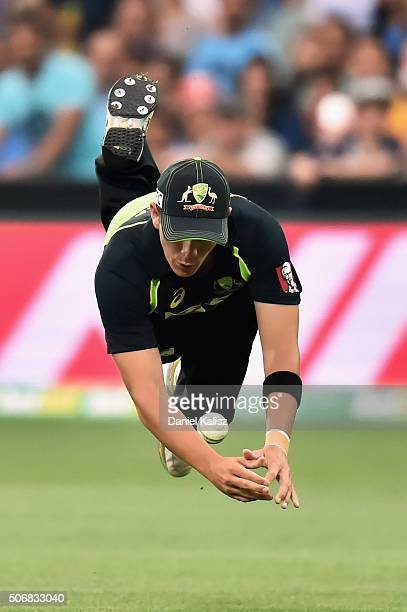 Cameron Boyce of Australia attempts a catch during game one of the Twenty20 International match between Australia and India at Adelaide Oval on...