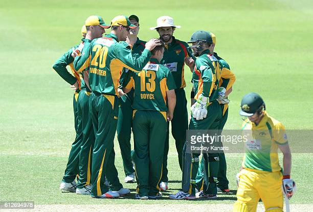 Cameron Boyce of Tasmania celebrates with team mates after taking the wicket of Will Bosisto of the CA XI during the Matador BBQs One Day Cup match...