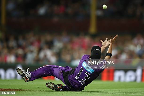 Cameron Boyce of the Hurricanes drops a catch during the Big Bash League match between the Sydney Sixers and Hobart Hurricanes at Sydney Cricket...