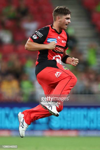 Cameron Boyce of the Renegades celebrates after claiming the wicket of Callum Ferguson of the Thunder during the Big Bash League match between the...