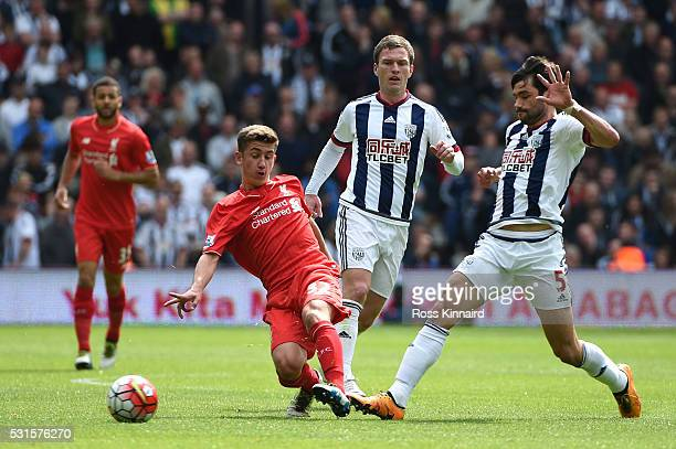 Cameron Brannagan of Liverpool and Claudio Yacob of West Bromwich Albion compete for the ball during the Barclays Premier League match between West...