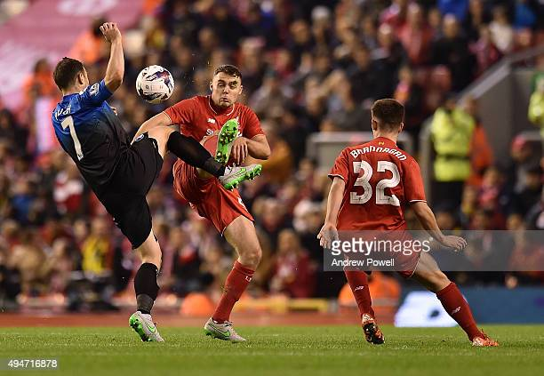Cameron Brannagan of Liverpool and Connor Randall of Liverpool compete with Marc Pugh of AFC Bournemouth during the Capital One Cup Fourth Round...