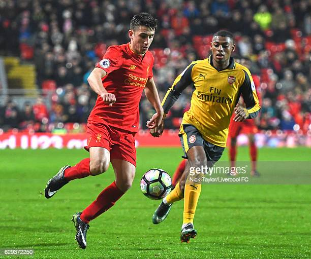 Cameron Brannagan of Liverpool and Jeff ReineAdelaide of Arsenal in action during the Premier League 2 match between Liverpool and Arsenal at Anfield...