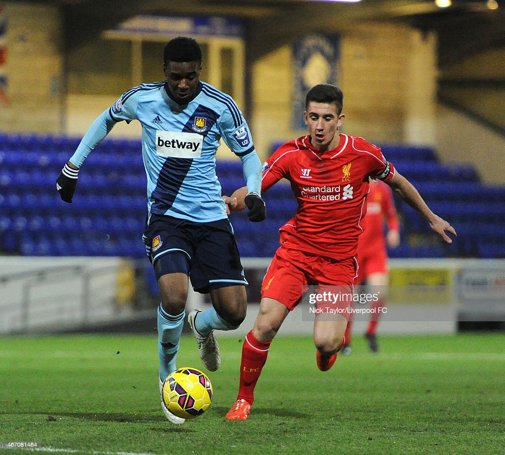 Cameron Brannagan of Liverpool and Moses Makasi of West Ham United in action during the U21 Premier League game between Liverpool and West Ham United at The Swansway Chester Stadium on March 20, 2015 in Chester, England.