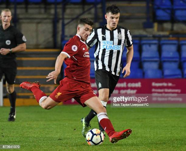 Cameron Brannagan of Liverpool and Victor Fernandez of Newcastle United in action during the Premier League International Cup match between Liverpool...