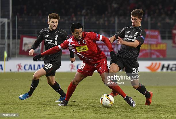Cameron Brannagan of Liverpool competes with Carlitos of FC Sion during the UEFA Europa League match between FC Sion and Liverpool FC at Estadio...