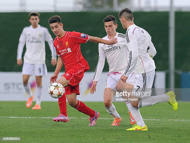 Cameron Brannagan of Liverpool competes with Jean Carlos of Real Madrid CF during the UEFA Youth League match between Real Madrid CF and Liverpool FC...