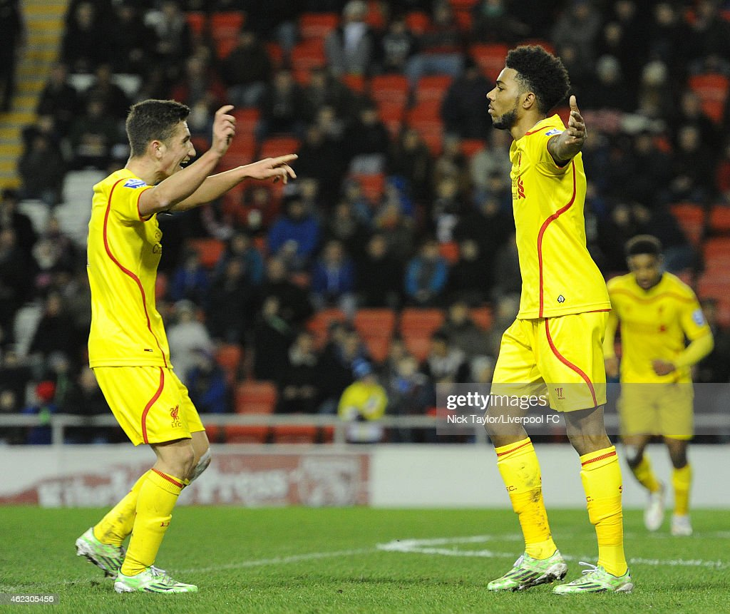 Cameron Brannagan of Liverpool (left) congratulates team mate and goalscorer Jerome Sinclair during the Barclays U21 Premier League match between Manchester United and Liverpool at Leigh Sports Village on January 26, 2015 in Leigh, Greater Manchester.