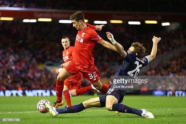 Cameron Brannagan of Liverpool is tackled by Nikica Jelavic of West Ham United during the Emirates FA Cup Fourth Round match between Liverpool and...