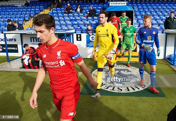Cameron Brannagan of Liverpool leads his team out followed by goalkeepers Daniel Ward and James Talbot of Sunderland for the start of the Liverpool v...
