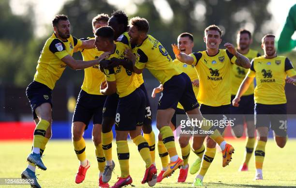 Cameron Brannagan of Oxford United is congratulated after scoring the winning penalty in a penalty shootout during the Sky Bet League One Play Off...