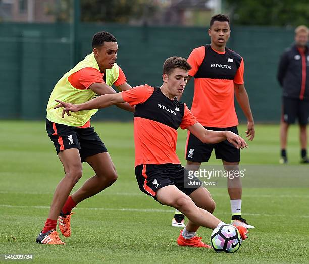 Cameron Brannagan with Trent Alexander Arnold of Liverpool during a training session at Melwood Training Ground on July 6 2016 in Liverpool England