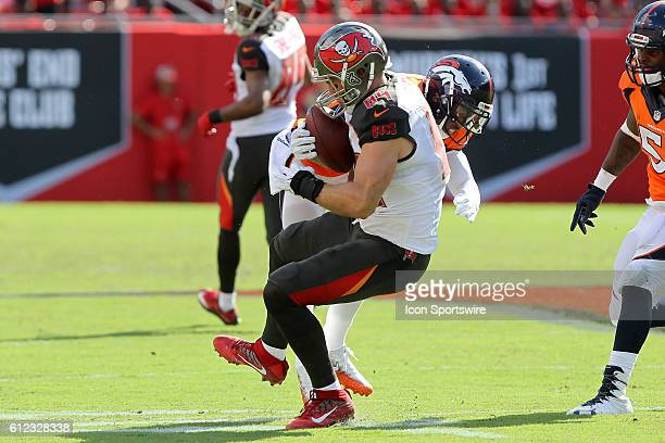 Cameron Brate of the Buccaneers makes a catch and is hit immediately by Chris Harris Jr of the Broncos during the regular season game between the...