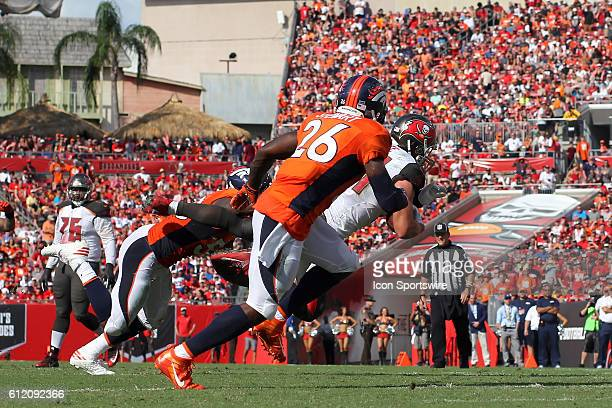 Cameron Brate of the Buccaneers reaches out to make the catch as Broncos defenders are all around him during the regular season game between the...