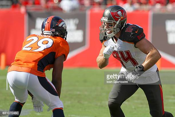 Cameron Brate of the Bucs takes off against Bradley Roby of the Broncos during the NFL game between the Denver Broncos and Tampa Bay Buccaneers on...