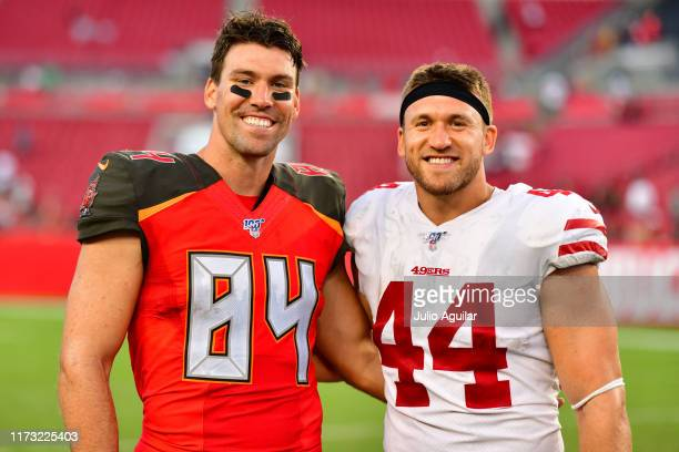 Cameron Brate of the Tampa Bay Buccaneers and Kyle Juszczyk of the San Francisco 49ers pose for a picture after a football game at Raymond James...