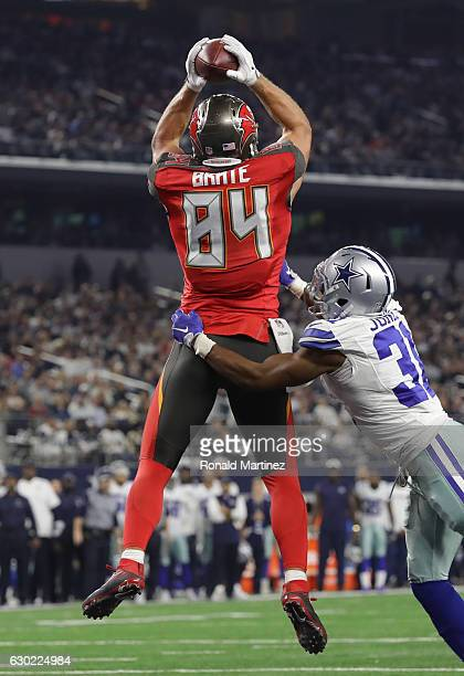Cameron Brate of the Tampa Bay Buccaneers catches a touchdown pass from Jameis Winston during the third quarter against the Dallas Cowboys at ATT...