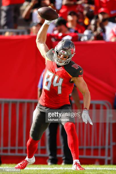 Cameron Brate of the Tampa Bay Buccaneers celebrates after a touchdown reception against the Atlanta Falcons during the first half at Raymond James...