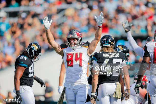 Cameron Brate of the Tampa Bay Buccaneers celebrates his team scoring a touchdown during the second quarter of a game against the Jacksonville...