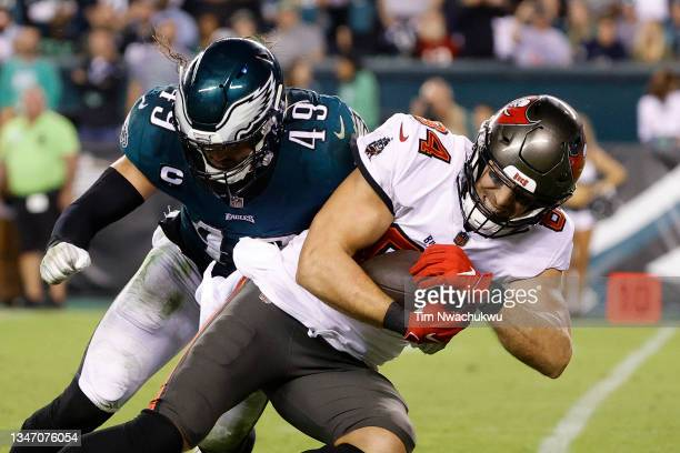 Cameron Brate of the Tampa Bay Buccaneers is tackled by Alex Singleton of the Philadelphia Eagles at Lincoln Financial Field on October 14, 2021 in...